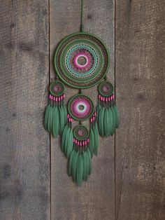 Dream catcher for lovers of green color. It combines different tone green and a pink colours. This is my author's dreamcatcher. The design includes five different size hoops, cotton thread, wooden beads and dyed goose feathers. Dream Catcher Decor, Large Dream Catcher, Dream Catcher Boho, Dream Catchers, Crochet Dreamcatcher, Crochet Mandala, Indian Arts And Crafts, Diy And Crafts, Crochet Wall Art