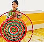 this is amazing! use a hula hoop and loops of scrap t-shirts to weave a rug!