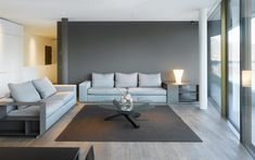 Residence in Tessin, Switzerland The living area is dominated by shades of grey true to the palette of Le Corbusier. The «Camp Fire Interior Design And Space Planning, Camp Fire, Le Corbusier, Zurich, Shades Of Grey, Outdoor Furniture, Outdoor Decor, Living Area, Switzerland