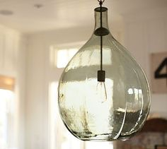 """Pottery Barn Clift Oversized Glass Pendant $399: Max 100 Watt bulb. The hand-blown glass features unique characteristics and a subtle green hue.  18"""" diameter, 26.5"""" high; 6' chain.  Hand-blown glass with a bronzed cap and matching chain."""