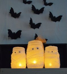 - Pint sized mason jar mummy votives. Flameless tea-light candle included. - This simple yet classic mummy votive is a big hit with the little ones! They love how it lights up and glows! Perfect addit