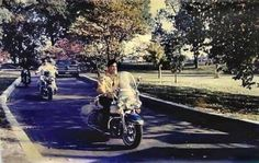 Let's go for a ride. Elvis and the guys heading down the driveway at Graceland. I wonder if Elvis bought them all the bikes?