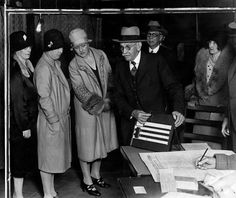Angelenos who marched to the polls in the November 6, 1928, election found voting machines in use at 105 precincts. Miniature dummy voting machines are provided for those unfamiliar with the use of voting machines, to learn and practice upon. Here an election official explains the system to a group of voters with the aid of the miniature machine at Precinct 780 at 420 South Hobart Boulevard   Source: photos.lapl.org