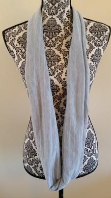 This handmade gray and silver stripe infinity scarf is made out of a stretch apparel fabric and would be a fabulous accent to any outfit!  Limited availability, while supplies last!