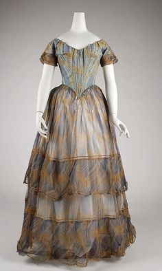 Striped blue dress with tan floral print and sheer skirt, American or European, 1840.