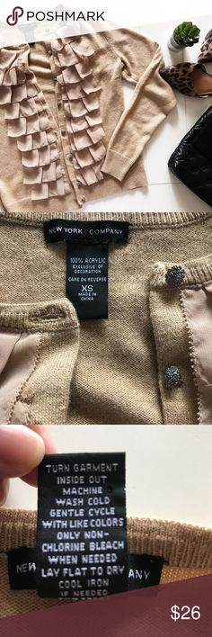New York & Co. - Button Front Cardigan Beautiful, beige/nude, rhinestone buttoned, cardigan from New York & Co. in great used condition!! The ruffles adds a delicate touch to this piece. Fits an XS/S in my opinion. No tears, snags, or stains. Offers welcomed! New York & Company Sweaters Cardigans