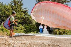 After Wedding Photogtaphy Groom and bride Paragliding in Myrtos Kefalonia