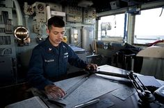 quartermaster 2nd class armen taymazyan assigned to the guided missile cruiser uss hue city