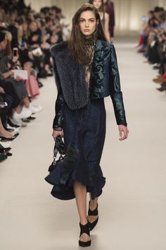 Despite the brand's illustrious peplum tops, and opulent fur overcoats, there was a noticeable lack of fullness, a void unconquered, at the Lanvin Fall 2016 presentation in Paris. It might have be...