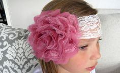 This vintage inspired baby headband features a 5.5 lace and chiffon flower in mauve on a 2.5 ivory lace elastic. All headbands are backed