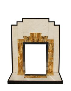 Art deco fireplace surround.  Reminds me of the Navajo patterns I see here in the southwestern United States.