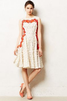 Aster Flared Dress #anthropologie  I LOVE the red detail on this dress!  And the big pleats on the skirt, and its perfect knee length - very classy.  I don't really like the textured fabric however