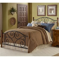 This steel and wood queen-size bed will add elegance and sophistication to any bedroom. The steel headboard and footboard features an intricate swirl motif detail on its curved headboard. Solid wood posts and steel bedframe make this bed durable.