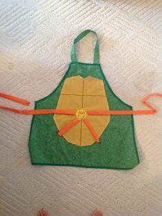 ... making apron so I designed him a Teenage Mutant Ninja Turtle one