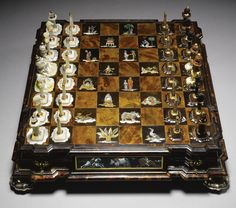 15  Attributed to the Johannes Mann (1679-1754) and Emanuel Eichel (1690-1752) workshop, German, Augsburg, circa 1720-30  A chessboard, with Pagoda figurines as kings and queens, and chess pieces in mother-of-pearl and aventurine glass  ESTIMATE: 200,000 - 300,000 GBP  LOT SOLD. 445,250 GBP (Hammer Price with Buyer's Premium)