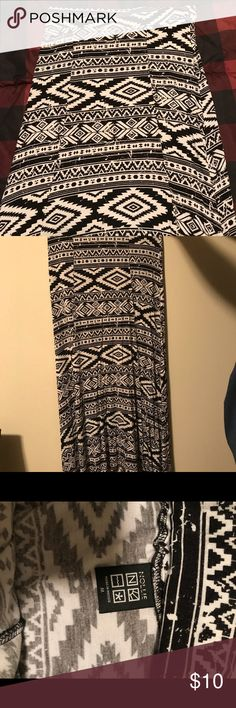 Black and White Tribal high/low skirt Black and White tribal high/low skirt. Worn once. Size medium. Great condition! Smoke free home Skirts High Low