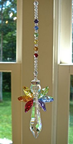 Rainbow Angel Swarovski Crystal Suncatcher by HeartstringsByMorgan $24.99!! rayban sunglasses is on sade! www.glasses-max.com