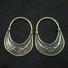 Temple rings are the most characteristic part of Slavic medieval dress. They are so called because they were worn on the headband, near the temples of a woman or a girl. Most were made of base metals such as copper alloys or iron, though silver and even gold were occasionally used... Bronze temple rings from medieval Slovenia by Sulik on Etsy.