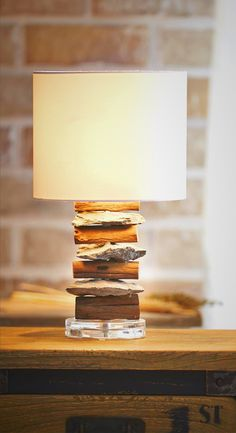 Wood and Stone Table Lamp. This Elements Design Accent Light is made from Dead Teak Trees' Branches, recycled driftwood, treated and assembled with rocks on Acrylic. With a natural look , this Masterpiece looks perfect and creates ambiance environment, brighten your days with interesting lights. It's great when placing on sofa sides your living room or bed sides bedroom. It could perfectly fit with industrial, loft or country home styles. Find more Ideas from O'THENTIQUE's Designer on our…
