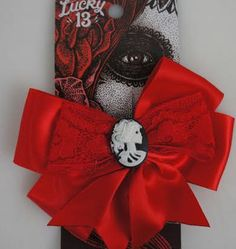 Satin Beauty Forever Cameo Hair Bow in Red by Lucky 13