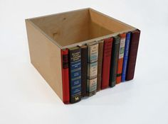 Added old book spines to a box to make a drawer