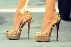 Christian Louboutin gold spiked heels.