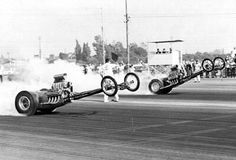 "Without question, one of the wildest and most photographed wheelie shots in history was of Norm Weekly in the ""Frantic 4"" A/FD against Don Moody in the ""Golden Thing"" AA/FD at the 1963 Winternationals."