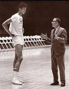 Kareem Abdul Jabbar, one of the greatest-ever college and professional basketball players, and his coach, UCLA's John Wooden, one of the greatest-ever college basketball coaches. Ucla Basketball, Basketball History, Basketball Legends, Basketball Players, Larry Bird, Basket Nba, Kareem Abdul Jabbar, Sport Icon, Sports Figures