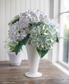 DIY Painted Paper Hydrangea. The thing I love about hydrangeas, real or paper, is that each lush head takes a lot of space, both physically and visually. So just a few of these intricate flowers make a real statement.