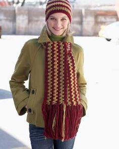 Matching hat and scarf set with wide stripes and fringe. Shown in Bernat Roving.
