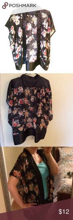 Free with any purchase- Floral kimono Black Satin-like lining on all trim with sheer floral rusty red/dusty rose green floral pattern - All items for BOGO!! Buy any item and get any item of equal or lesser value free!  This goes for my entire closet! Use the buy now button and comment on your free item to be included. Also please comment on any item of $5 or less in my closet to be included in your package. That's 3 items for the price of one!! Tops