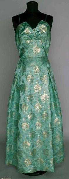 "BROCADE SATIN BALLGOWN, c. 1950 Aqua satin w/ gold brocade rose blossoms, spaghetti straps, bell skirt, B 38.5"", W 31"", L 59.5"""
