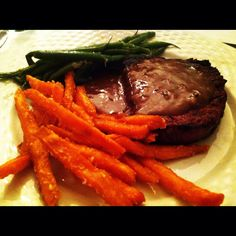 Filet mignon with triple pepper corn sauce, with sweet potato french fries and green beans French Fries, Green Beans, Sweet Potato, Steak, Potatoes, Stuffed Peppers, Food, Filet Mignon, Curly Fries