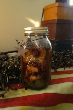 Mason jar oil lamp. Add cinnamon stick, pine cones, berries etc.
