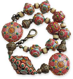 Patricia Beuting. Ethnic meets bohemian meets Christmas.Polymer sliced for the holidays.  Find her links on PC Daily and see her Flicker site: http://patriciabeuting.com/afrika-thema/