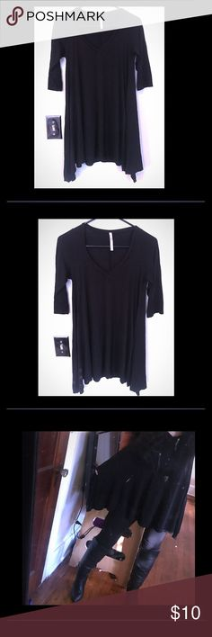 Asymmetrical black v neck tunic V neck asymmetrical tunic! Twirl around in this adorable top! Wear with jeans or leggings! Tops Tunics