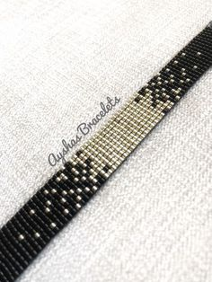 BUY 2 GET 1 FREE Black and Silver Miyuki Bracelet / Beaded Bracelet / Minimalist Style / Miyuki Bead Bracelet / Miyuki Delica by AyshasBracelets on Etsy https://www.etsy.com/uk/listing/582125382/black-and-silver-miyuki-bracelet-beaded