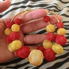 Red and Gold Hoop Earrings.