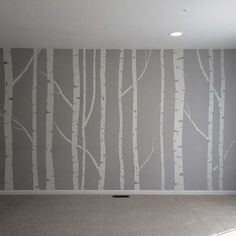 Hand painted birch tree wall mural - made by taping off the trunks and branches, then going back over it to brush in the details.