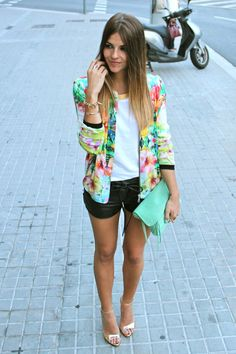 bright floral and leather shorts.