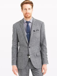 A slim-fitting tweed suit? That's not going out of style anytime soon.