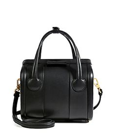 Finish your look on a ladylike note with this chic structured handbag from Marc by Marc Jacobs #Stylebop