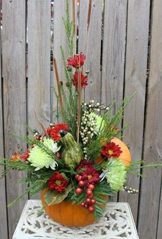 Autumn fresh flower arrangement in pumpkin
