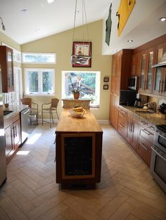 narrow kitchen island in former galley style kitchen