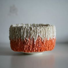 This little piece is made up of three tones of coloured porcelain, each applied once around the piece, before fading into white. I think next time I'm going to fire the kiln a few degrees cooler to bring the tones down a little . . . . . #colour #ceramics #porcelain #orange #coral #ceramics #ceramica #teabowl #texture #summer #ceramique #design #livefolk #bowl #ceramicart