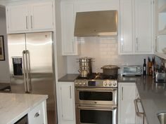Photo of Jamie's Kitchen Cabinets and Bath - Rosemead, CA, United States. Custom shaker white inset maple cabinetry, concrete gray quartz, subway tile backsplash