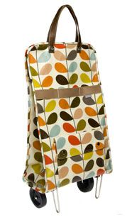 I love Orla Kiely fabrics, and this rolling bag will minimise your footprint on escalators, etc. Not as stable as a proper trolley, but there's a nice range of patterns and colours.