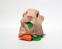 Unique one of a kind handmade polymer clay Guinea Pig.  Measurements: 4.5cm Long, 2.1cm Tall  *Please note - This is a collectible figurine, not a
