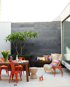 Using stone on a feature wall outside can enhance your garden in so many ways.