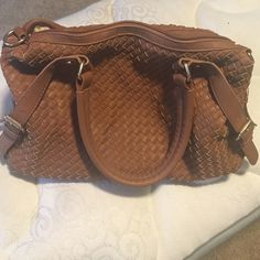 Maurice's brown basket-weave purse Brown leather basket-weave purse by Maurice's. Interior floral design. Exterior has brown leather straps on front and back (looks like a belt), along with brown leather handles. Excellent shape! Maurices Bags Shoulder Bags